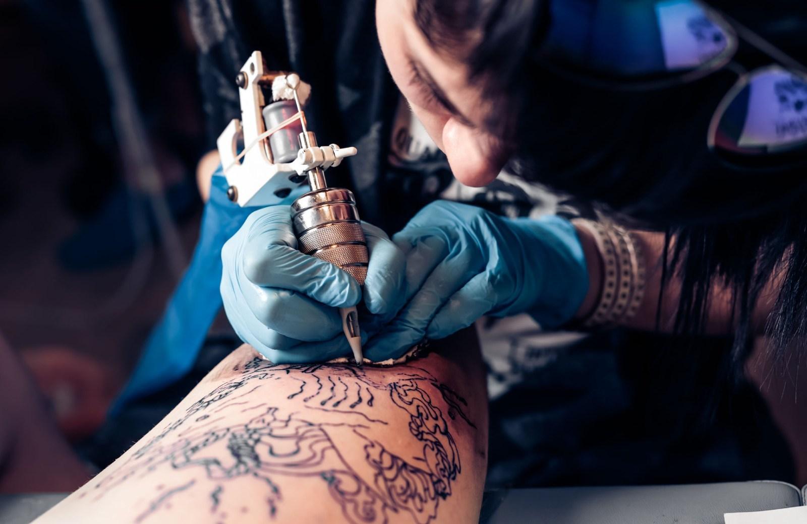 tattoo artist at work